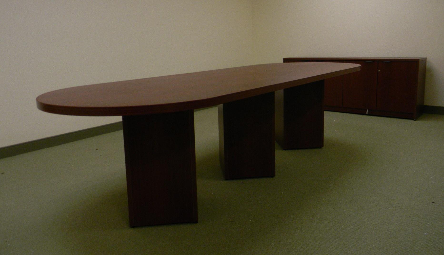 Standard laminate conference table with cube base.