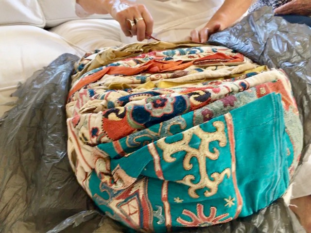 A Suzani parcel takes months to get to Cape Town and they have to be very well protected within the hand sewn cloth bag with the wax stamps on it. Cutting away at the plastic is a delicate challenge.