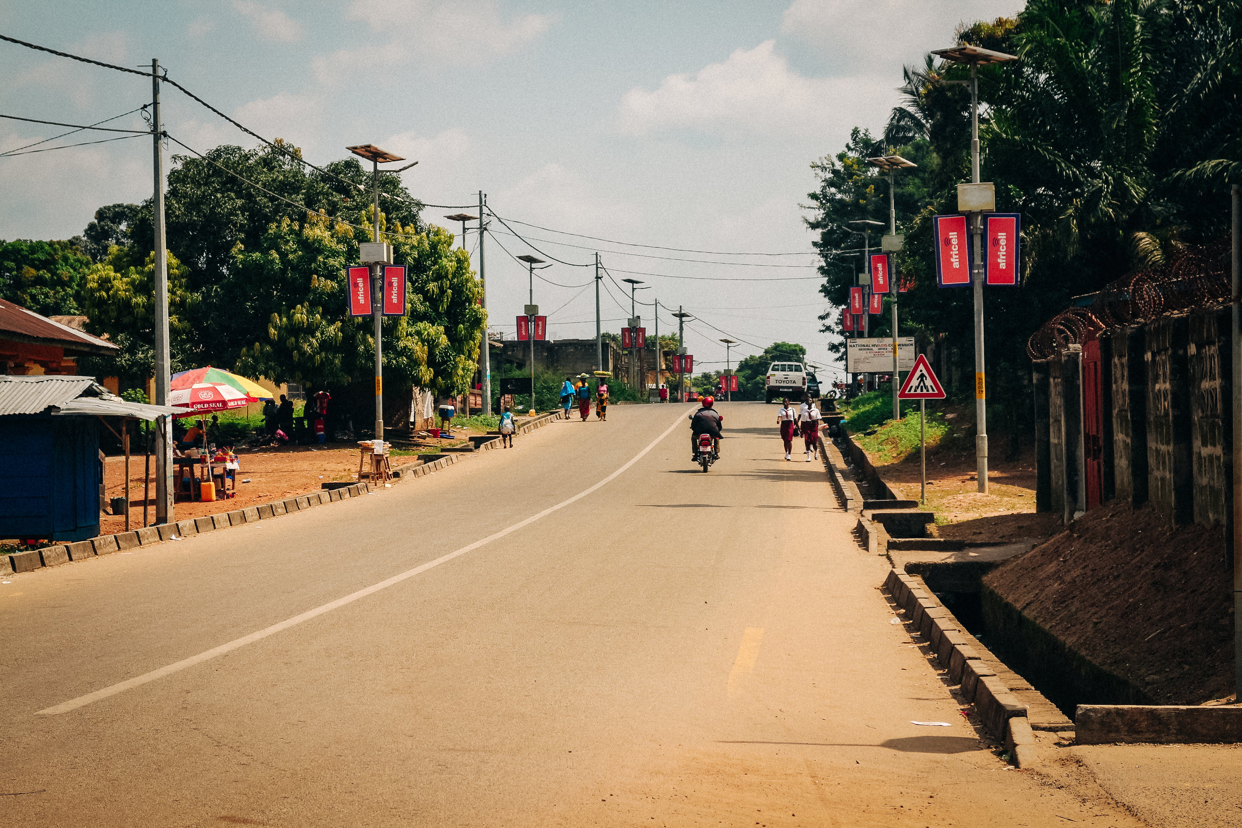 … to the tarmacked streets of Makeni.