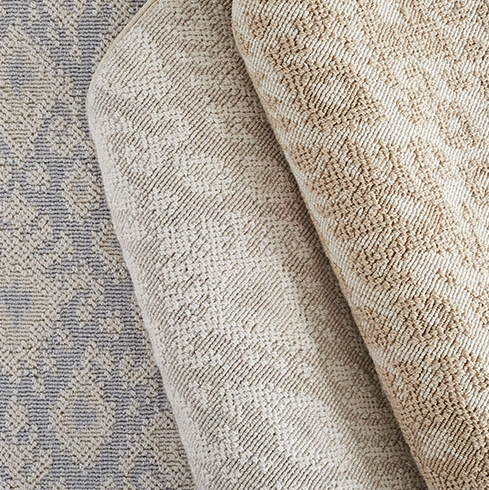 We chose an excitingnew product by Stanton Carpet, for the cut and surged template arearug that will provide a beautiful, transitional design with a soothing tone-on tone pattern, for a nice, durable,updated feel.