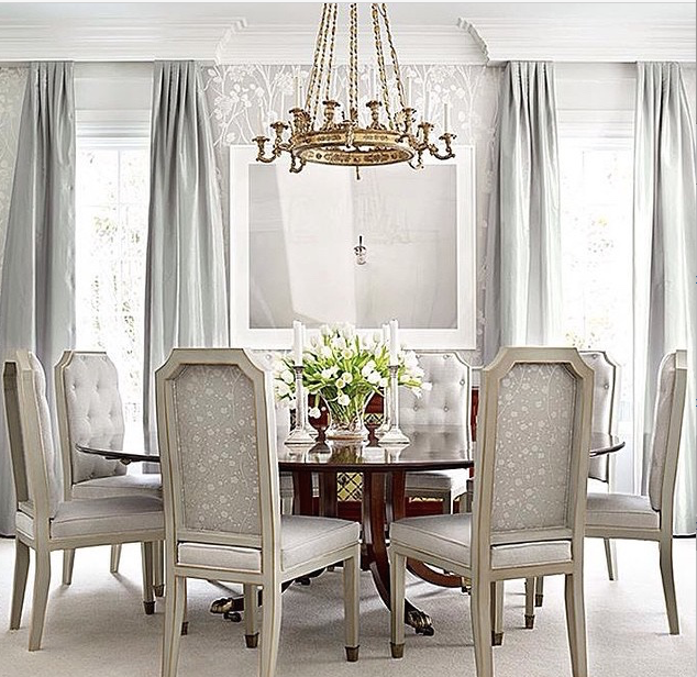 My client sent a few inspiration images to portray her wishes as far as style and energy for their space. This picture really spoke to me with the upholstered chairs, silk draperies, subtle wall covering, and dark table for contrast and depth. Achieving comfort and elegance is key.