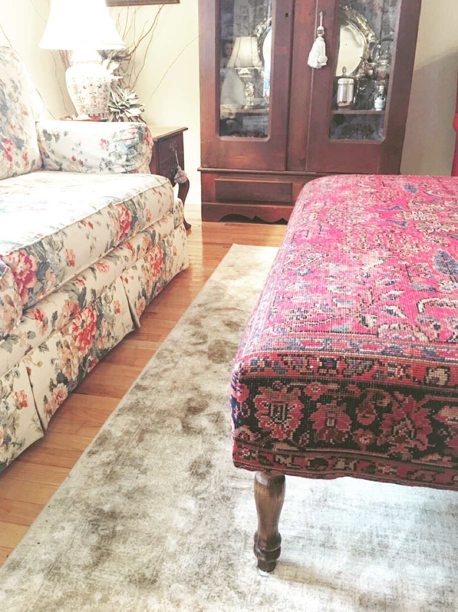 Mother-in-Law, Kathryn's Sitting Room off the Kitchen featuring an antique armoire, new viscose rug, and rug ottoman!
