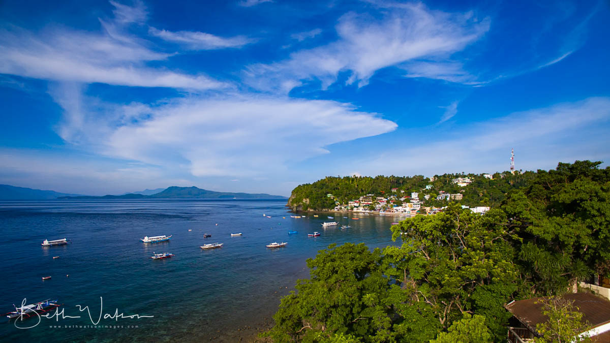 Sabang Bay with Verde Island in the background.