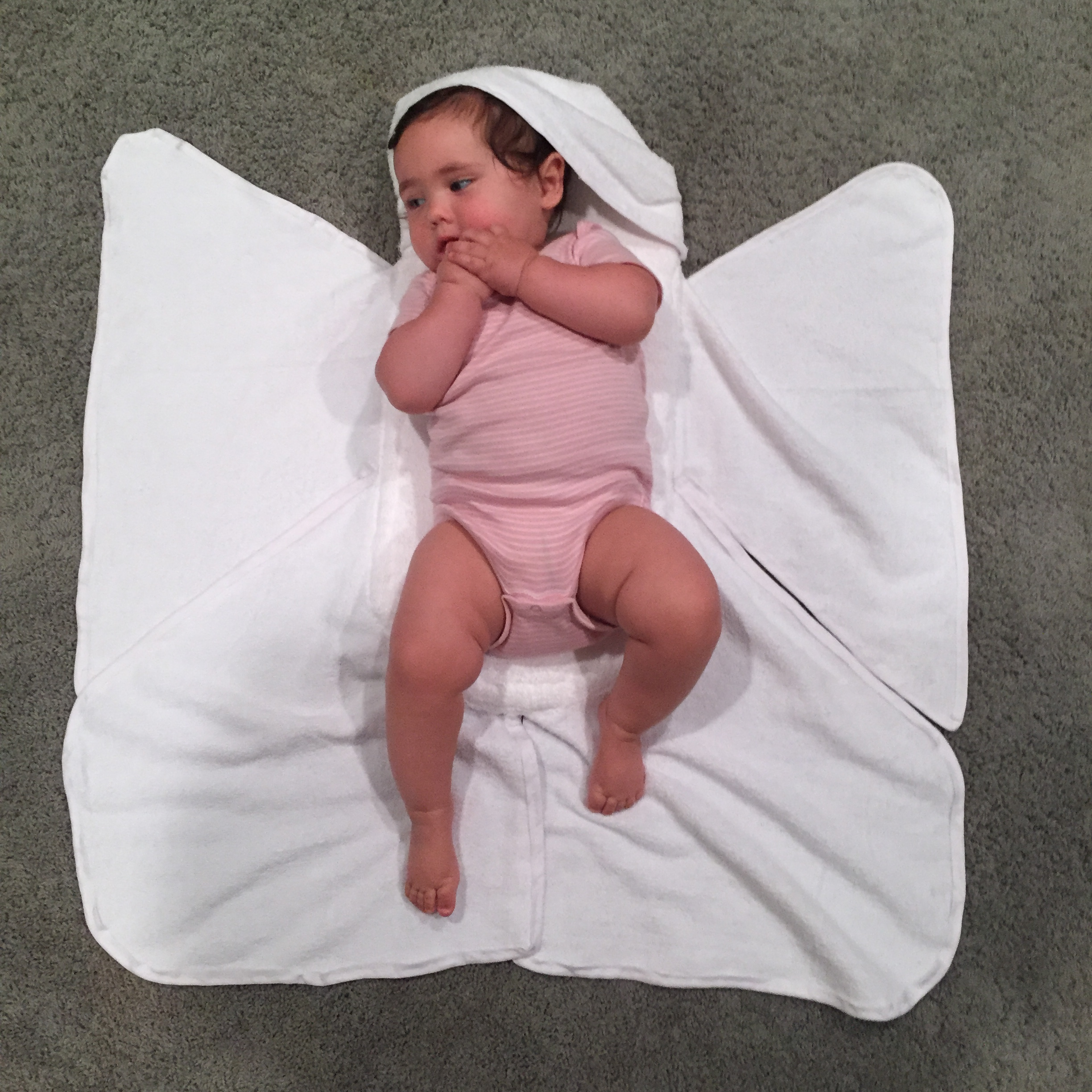 Marlo modeling the second homemade Snow Angel prototype I created. This version didn't have an adjustable hood. That feature was designed to make it appropriate for younger, smaller babies. Marlo was just under 9 months old when this was taken.
