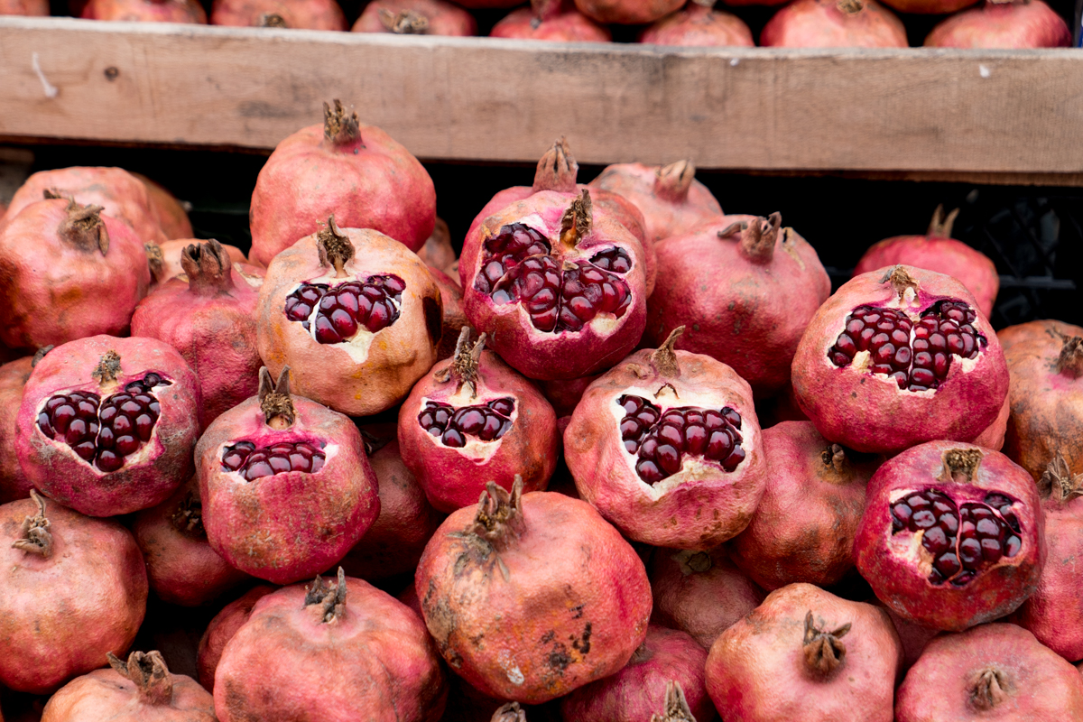 Pomegranates stacked and ready to sample at the market.