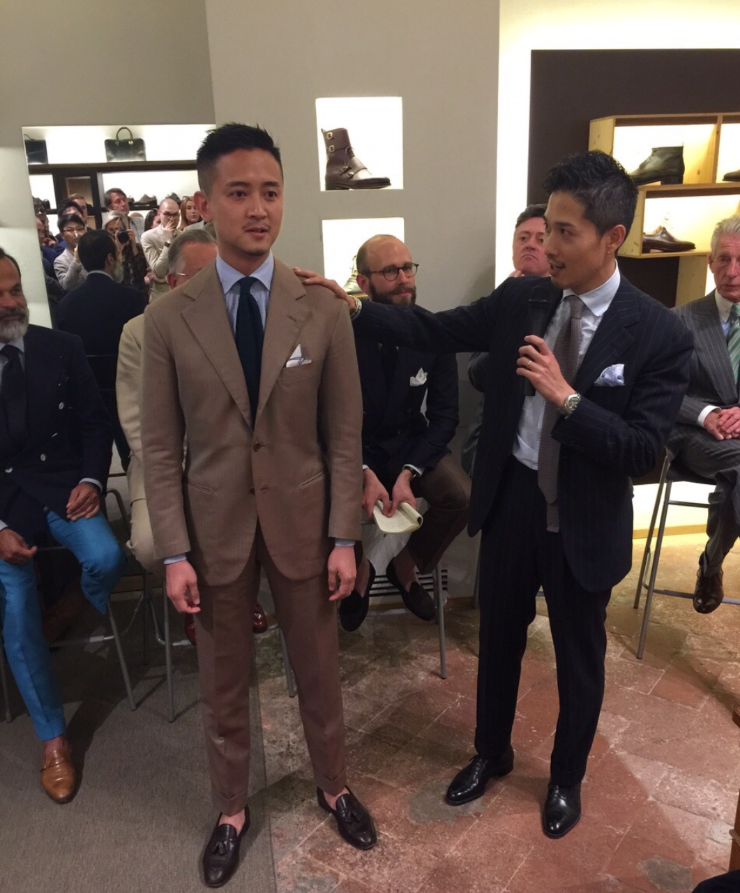 (Alan See, The Armoury Hong Kong serves as a demonstration model asTakahiro Osaki (AKA Taka), Liverano & Liverano discusses and shows the crowd what lies behind the art andcraftsmanship of a Liverano Bespoke Garment.