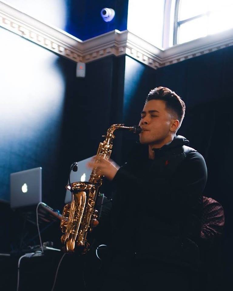A man playing the saxophone.
