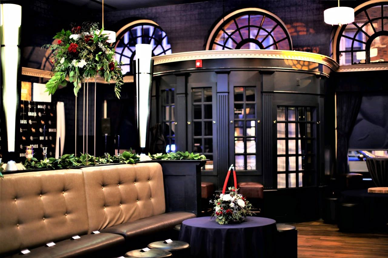 The front of the lounge decorated with Christmas style plants.