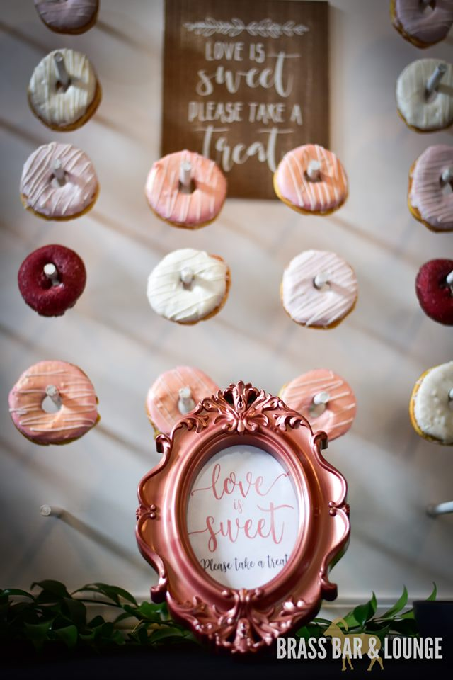 A closeup view of a donut wall with a framed quote in front of it.