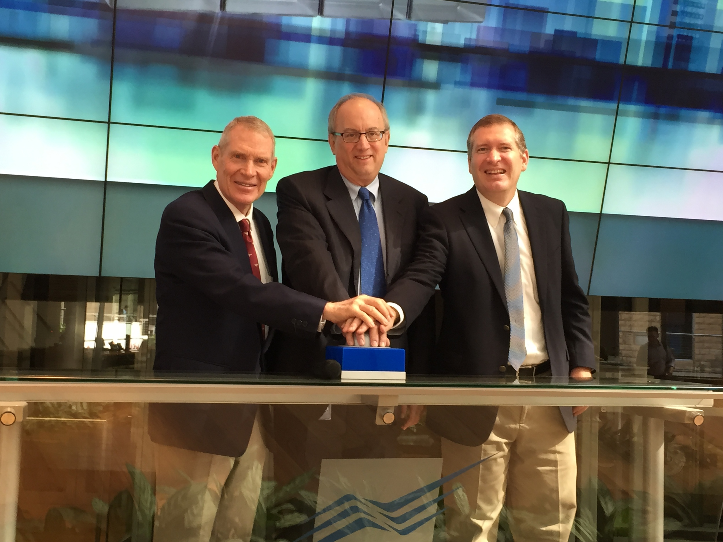 Ringing the bell at the Tel Aviv Stock Exchange. (From left: Larry Lunt, Yossi Beinart, and John Lunt)