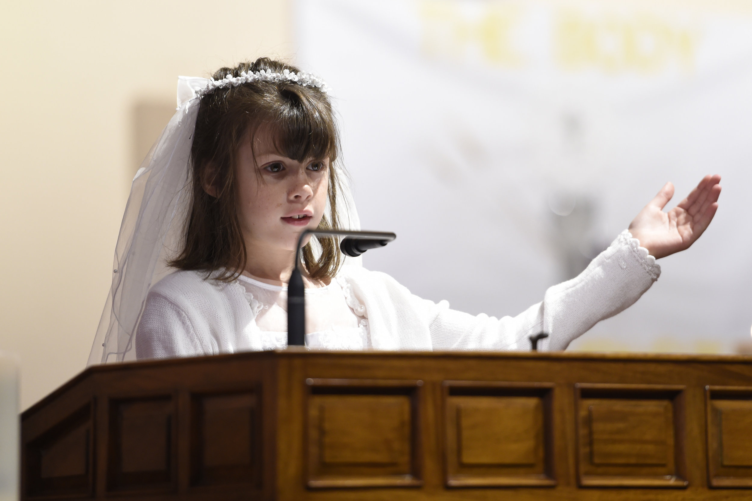 2024 1st communion student at podium.JPG