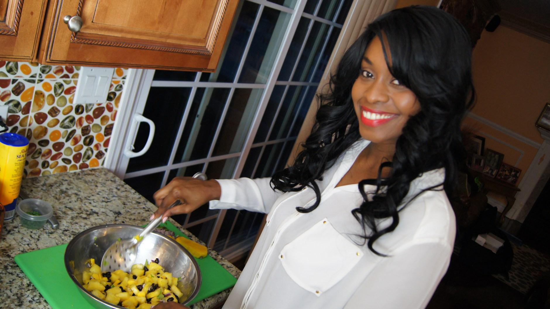 Nola preparing a sumptuous mango pineapple & black beans salsa