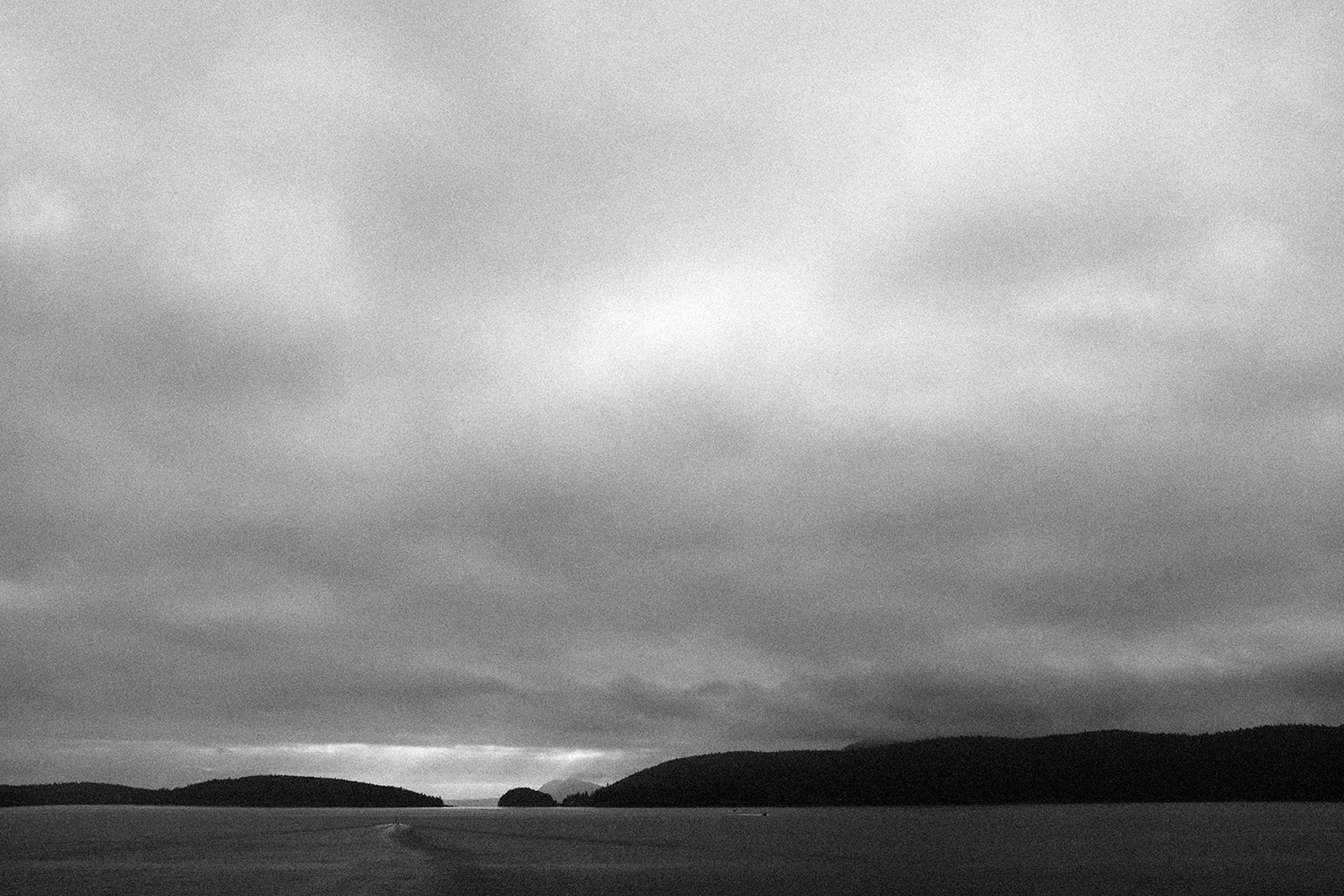 Sunset through the dense cloud cover during the ferry ride from Anacortes, WA to Orcas Island.
