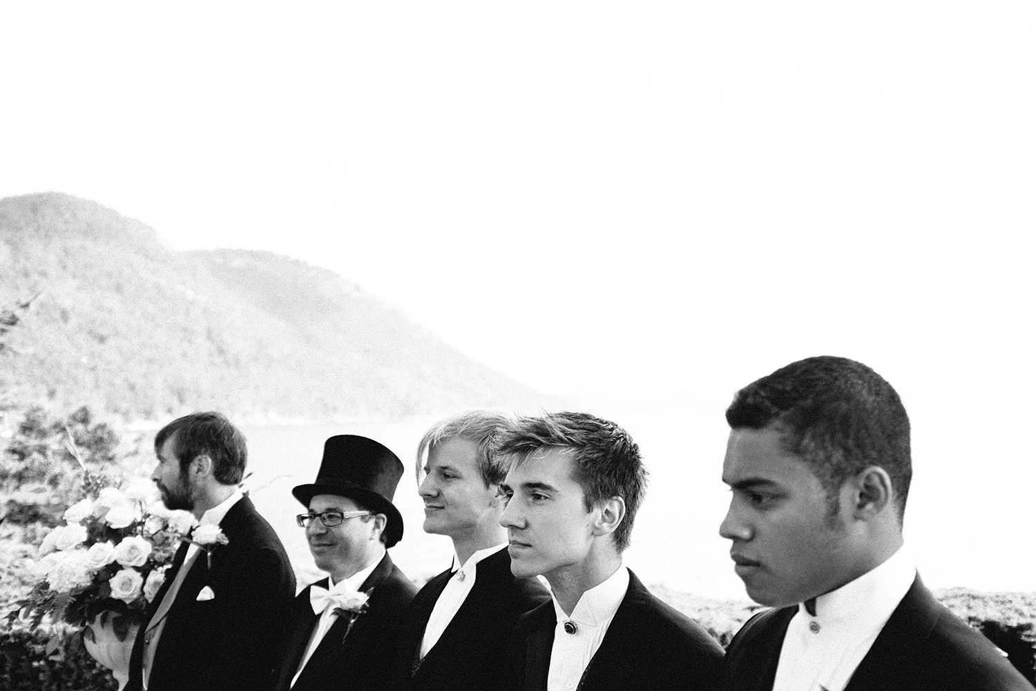 Groomsmen during a wedding ceremony on the Point Lawn, overlooking the bay