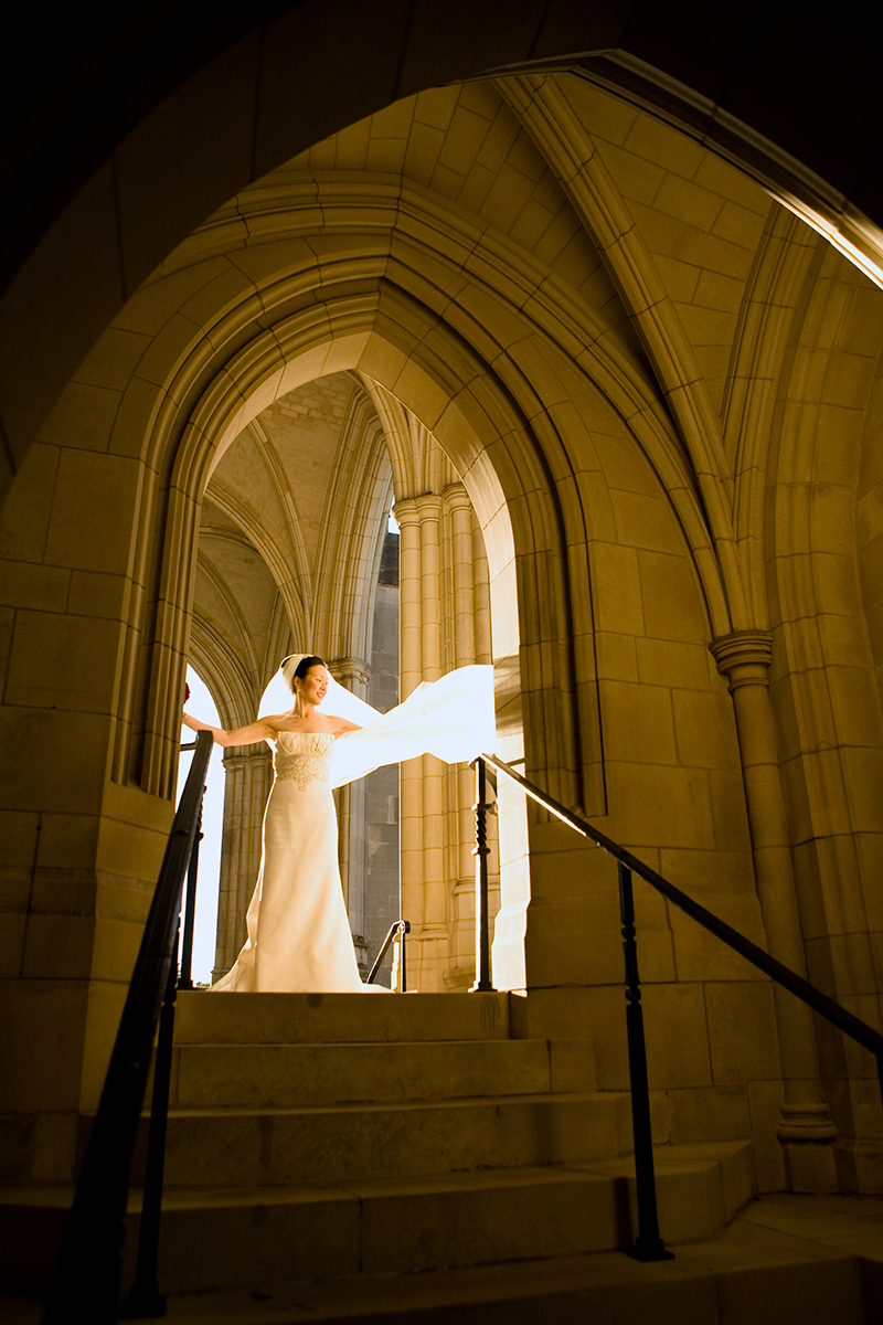 Bride in the wind at National Cathedral in Washington, DC