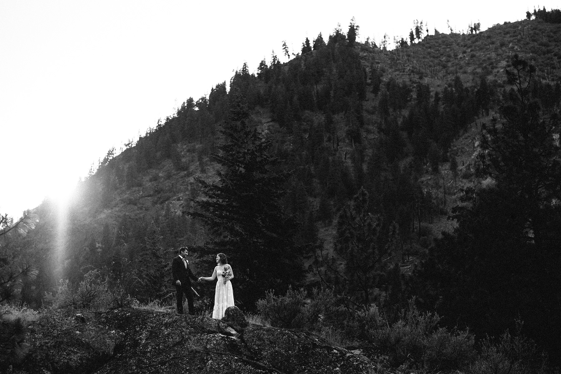 Couple on the bluffs at sunset at wedding in Leavenworth, WA