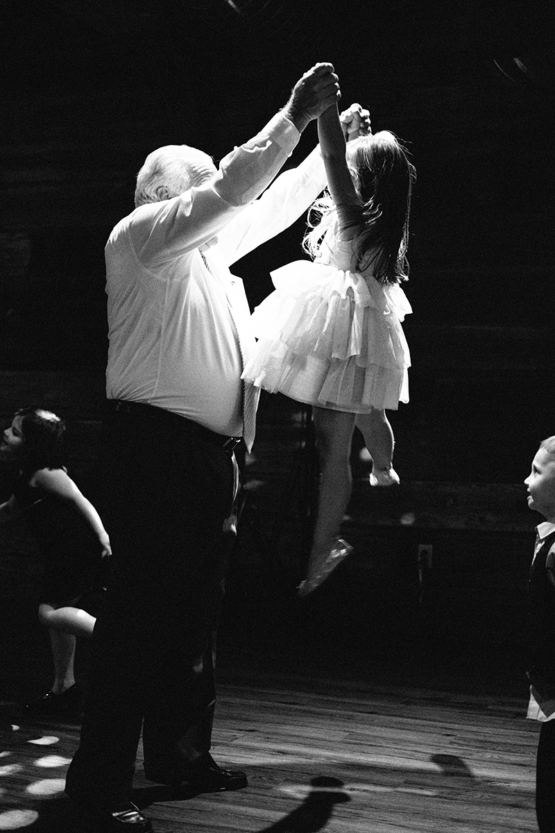 Grandfather dances with the flower girl and ring bearer at the Lowertown Event Center in downtown St. Paul, MN