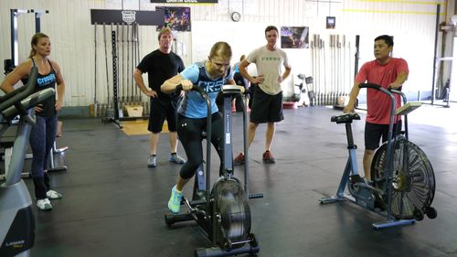 Melissa and her cheer squad   _______________________    Workout   Clean 3-3-3-3-3 at 80% of 1-rep max  Then,  12-minute AMRAP: 12 dumbbell snatches, alternating arms 24 squats 36 double-unders
