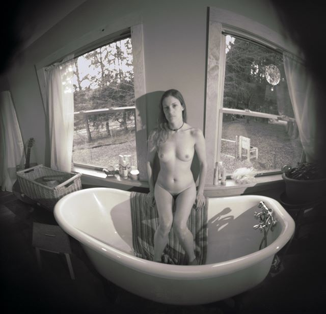 Helen by Dan McCormack. Extreme wide angle distortions of the round oatmeal box pinhole camera and subtle colorization create a series of visceral images.  #ArttakesManhattan #NewYorkArt #Exhibition #Collecting #NYart #Show ArttakesManhattan.org