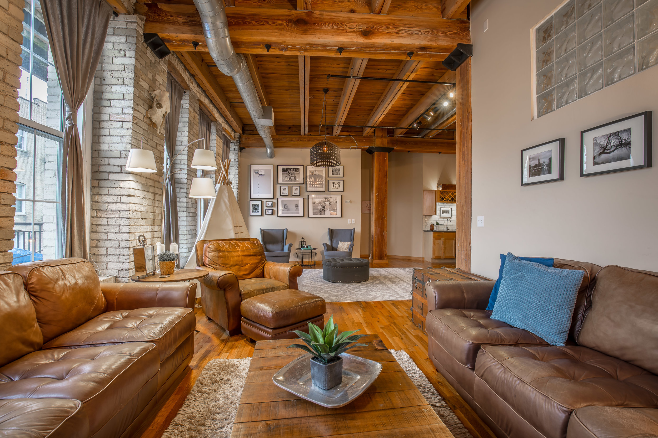 The unit boasts a variety of architectural details including 14 foot ceilings, wood pillars, cream city brick, and exposed duct work & joists. West facing balcony for outdoor enjoyment on warm summer nights