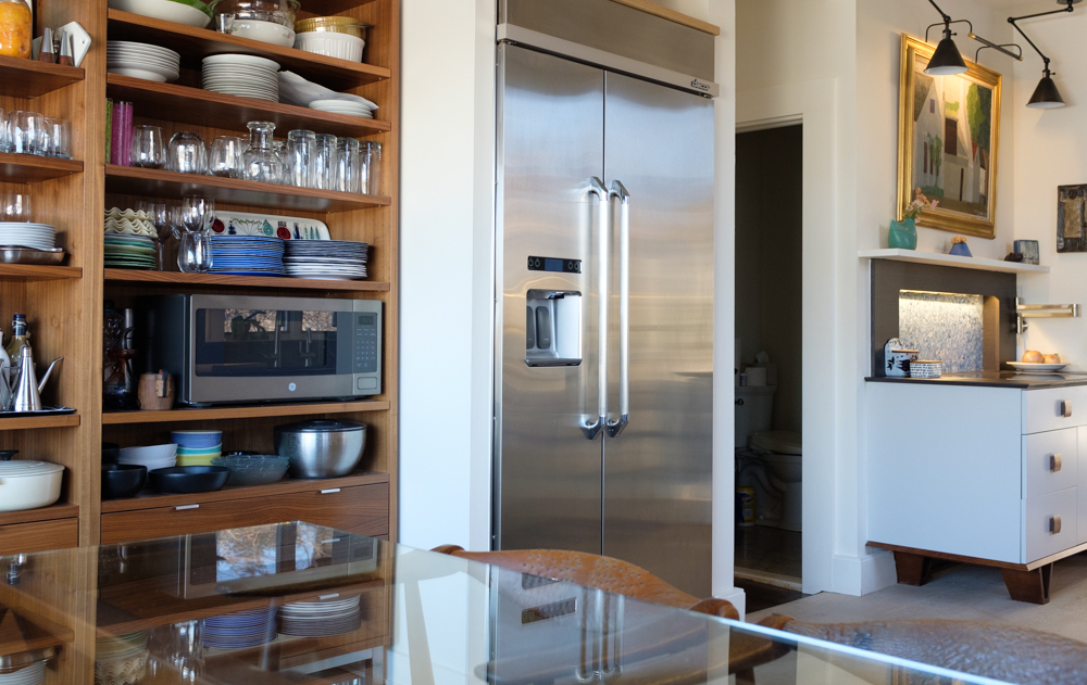 Sometimes a microwave on a shelf just works.It can be designed to hide in plain sight!