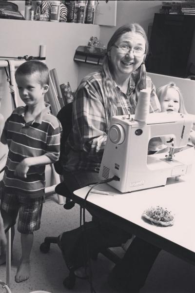 Nancy Lee teaching grandkids to sew