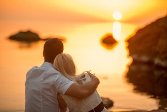 bigstock-couple-sitting-on-the-beach-at-52209439.jpg