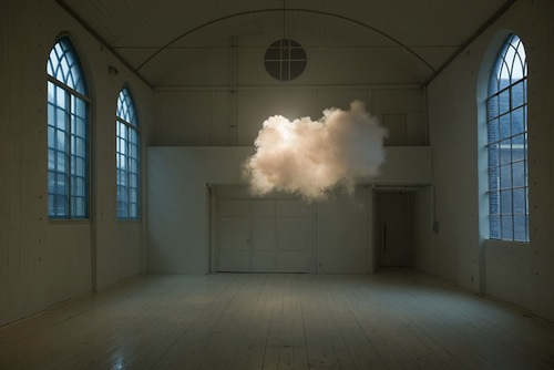 By perfecting the  atmosphere in a room, Dutch artist  Berndnaut Smilde  makes clouds appear out of thin air.    In what seems like  Photoshop or magic, Smilde carefully regulates the humidity, temperature and light of a space—and when the moment is right, he summons the cloud using a fog machine.    The cottony cloud  only lasts a few moments for it to be captured on film, and suspends in the middle of the room just before it collapses—evoking a sense of surrealism and ephemerality of nature.    Watch Video:  Click Here      via: Design Taxi
