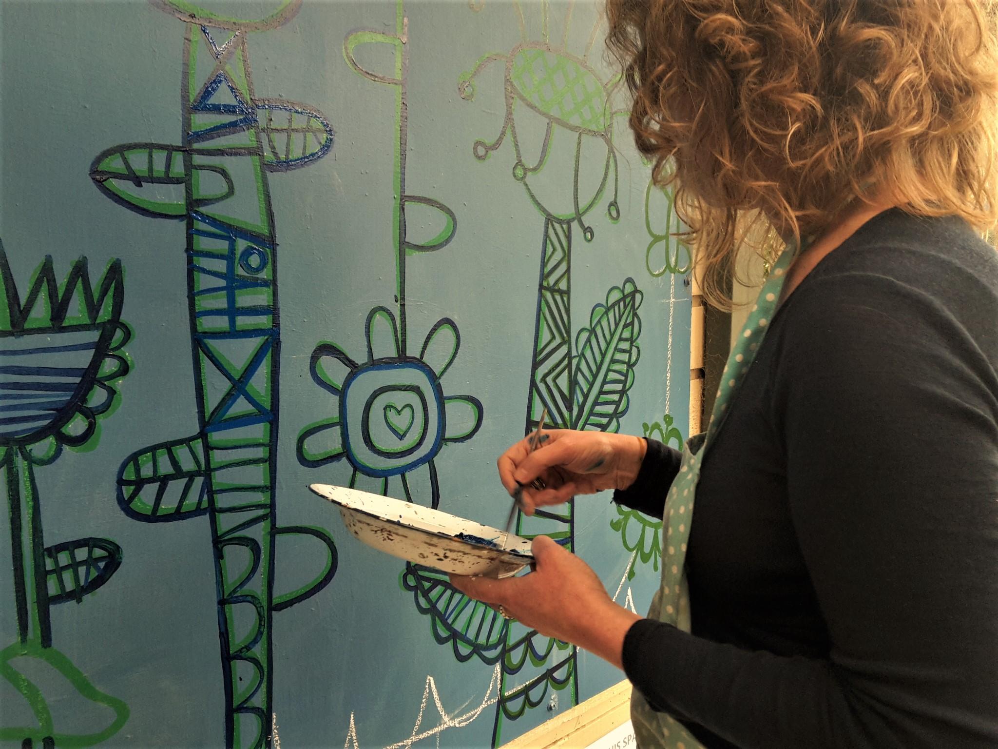 Sara working on the mural at Coonara