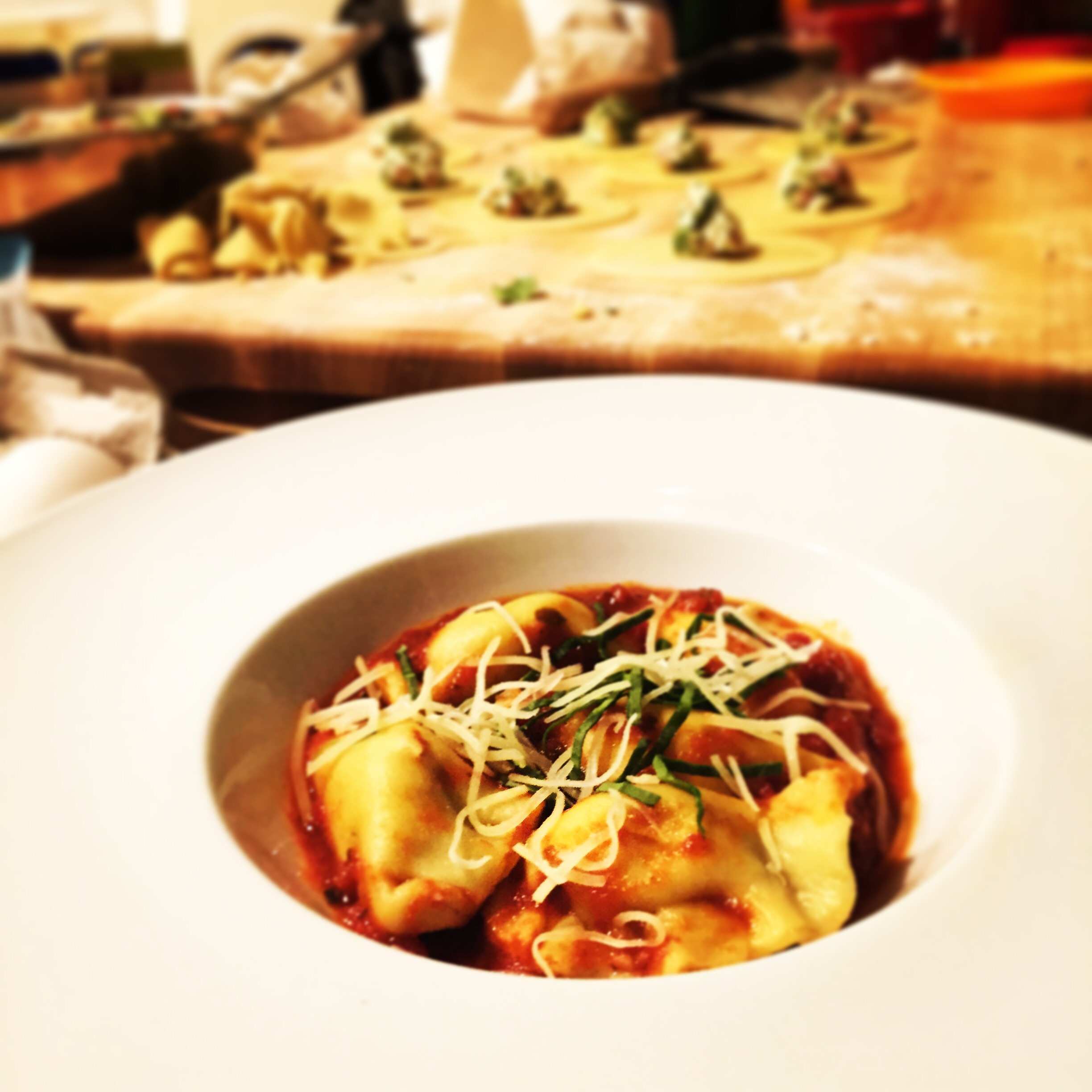 {Gluten free ravioli stuffed with spinach ricotta and prosciutto served in a simple tomato sauce}