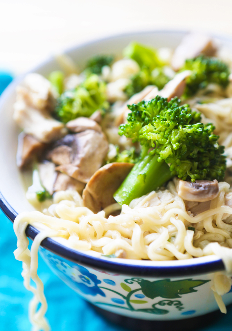 side view of a bowl with ramen bowl recipe with broccoli and mushrooms in it