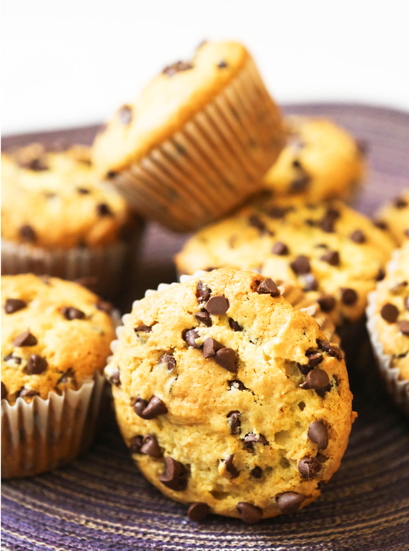 chocolate chip muffins piled on a placemat