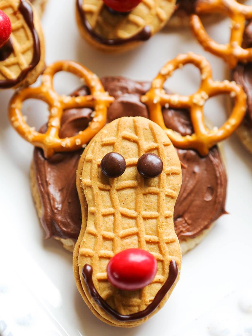 close up of reindeer cookies with pretzel antlers