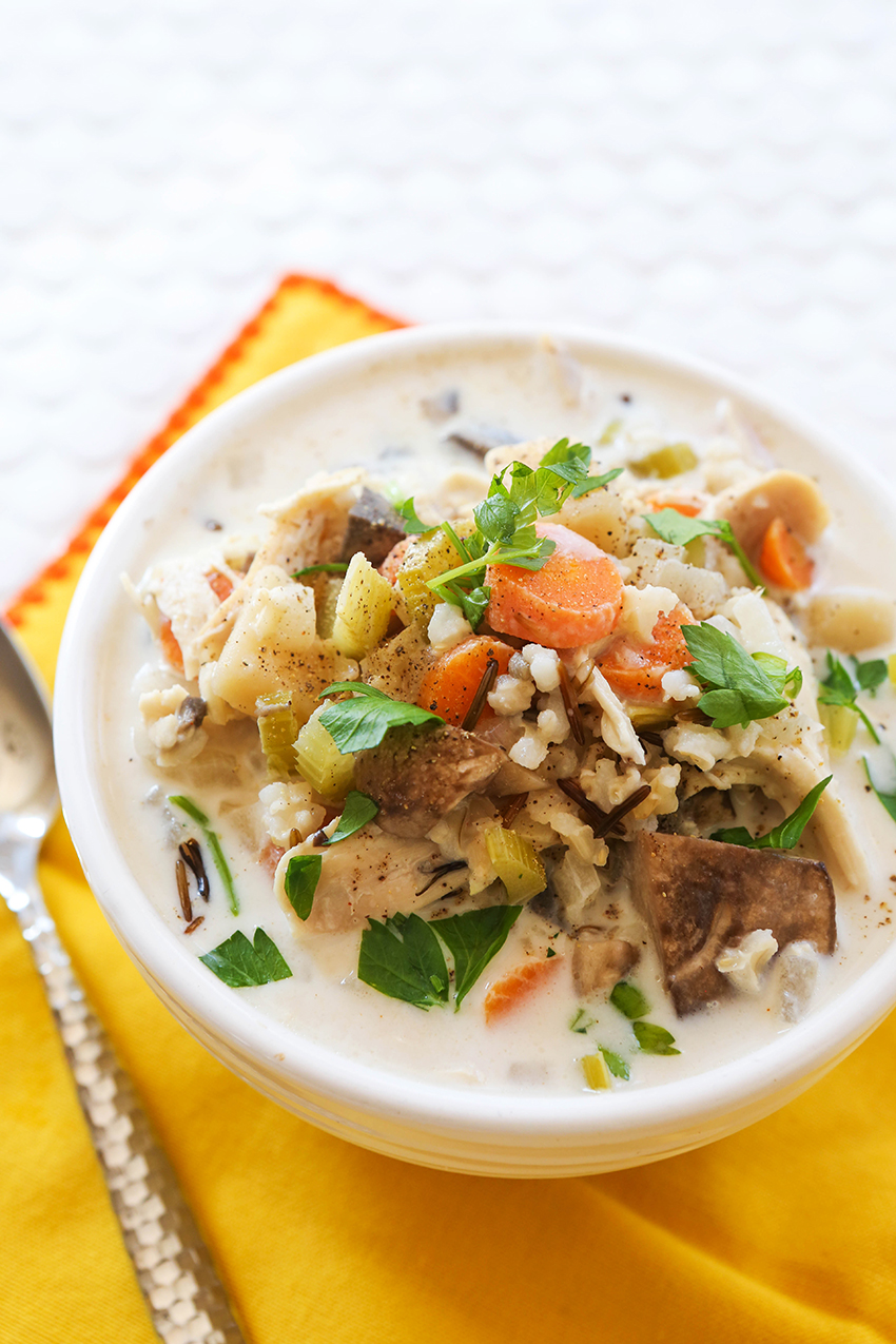 bowl of overflowing crockpot chicken wild rice soup