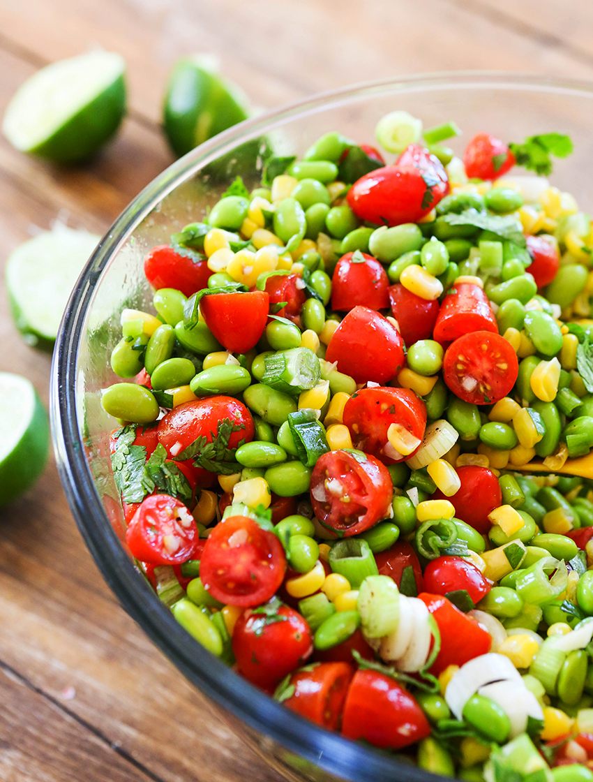 huge bowl of edamame salad with serving spoon inside