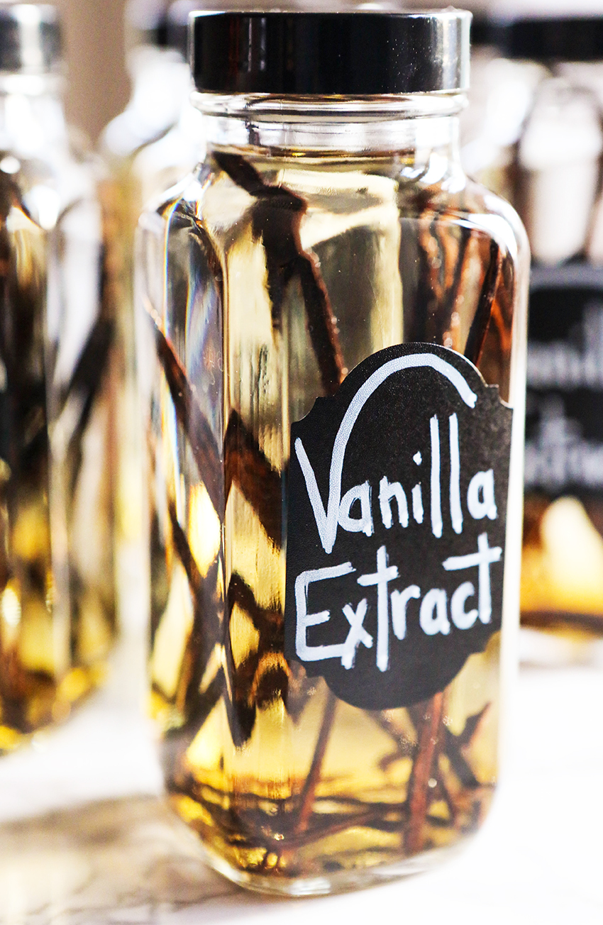 homemade vanilla extract in a jar with vanilla beans inside
