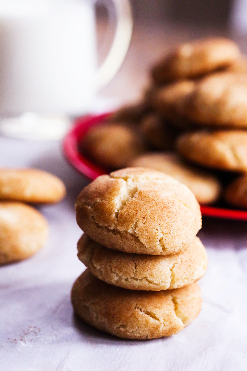 three snickerdoodles stacked in front of serving plate