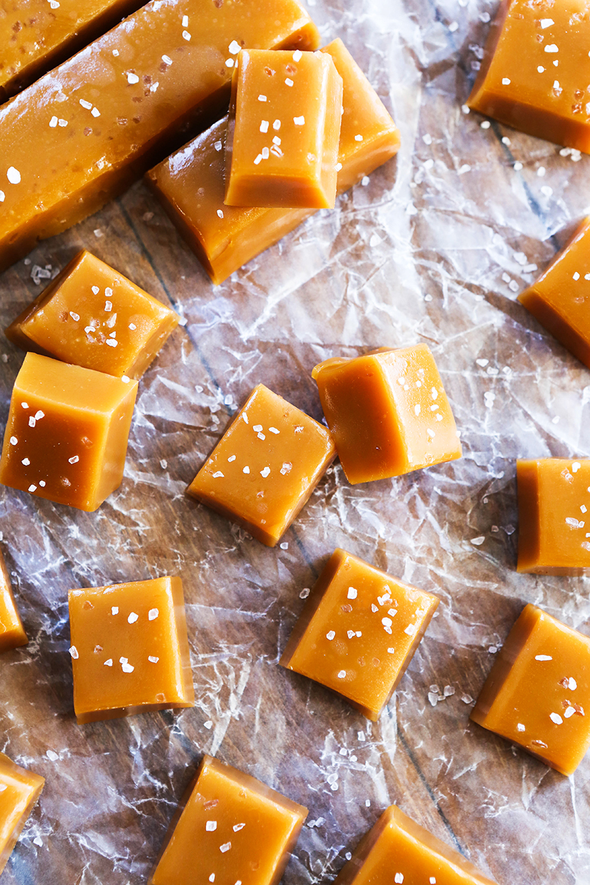 stacked bourbon caramels that have been sprinkled with salt