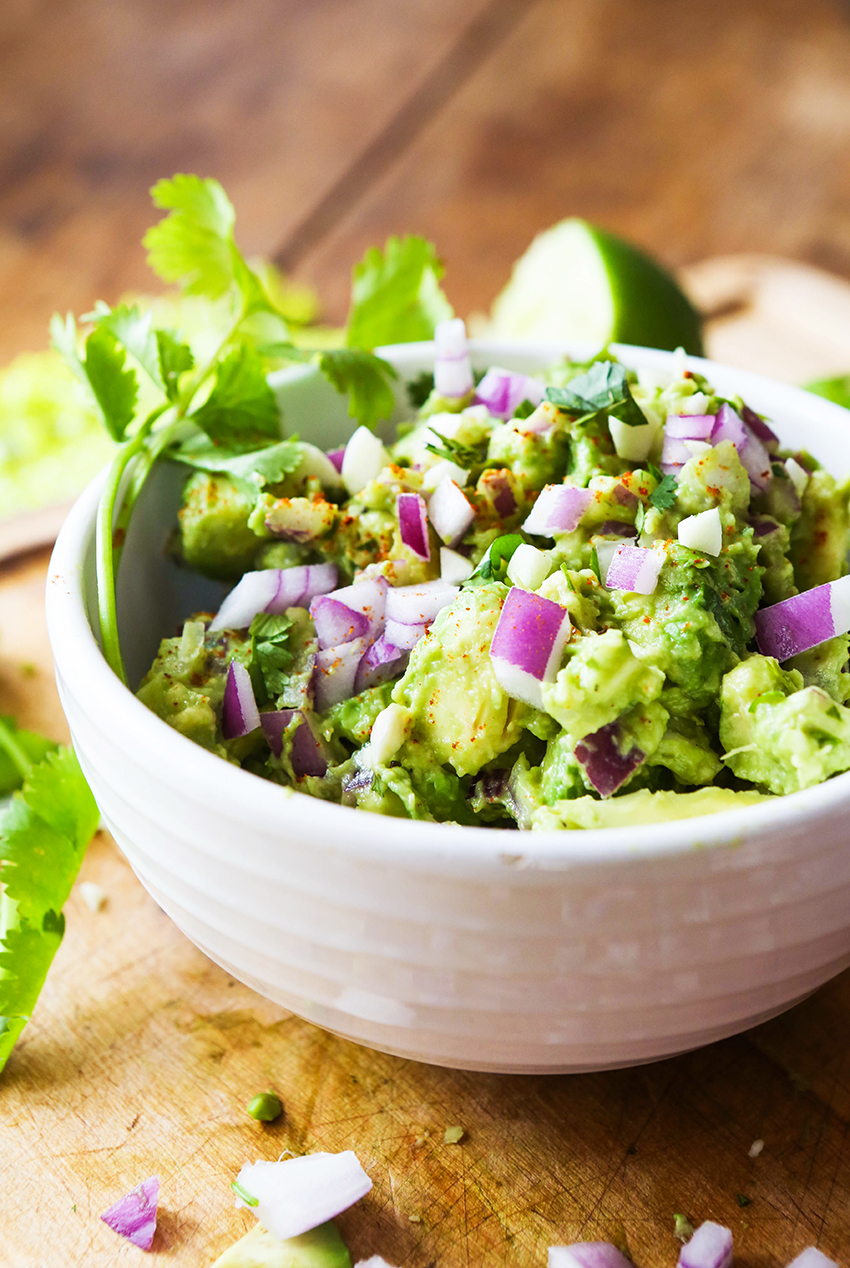 A close up of a prepared bowl of classic guacamole