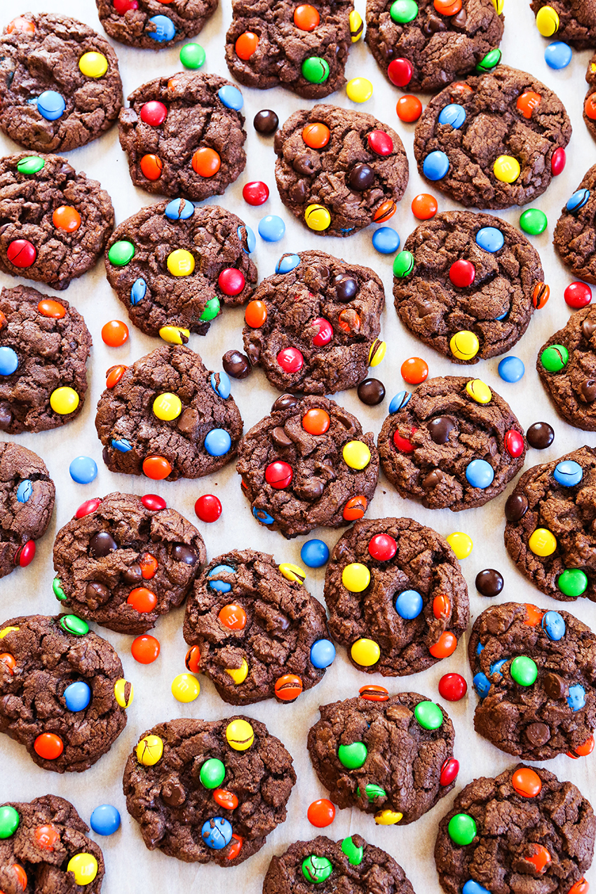 top view of lots of chocolate cookies with M&M's pressed into them