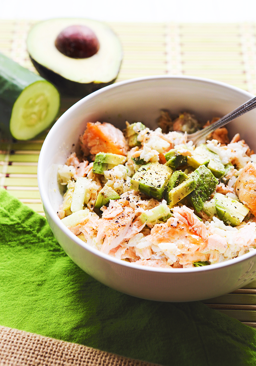 salmon sushi bowl with avocado chunks ready to eat