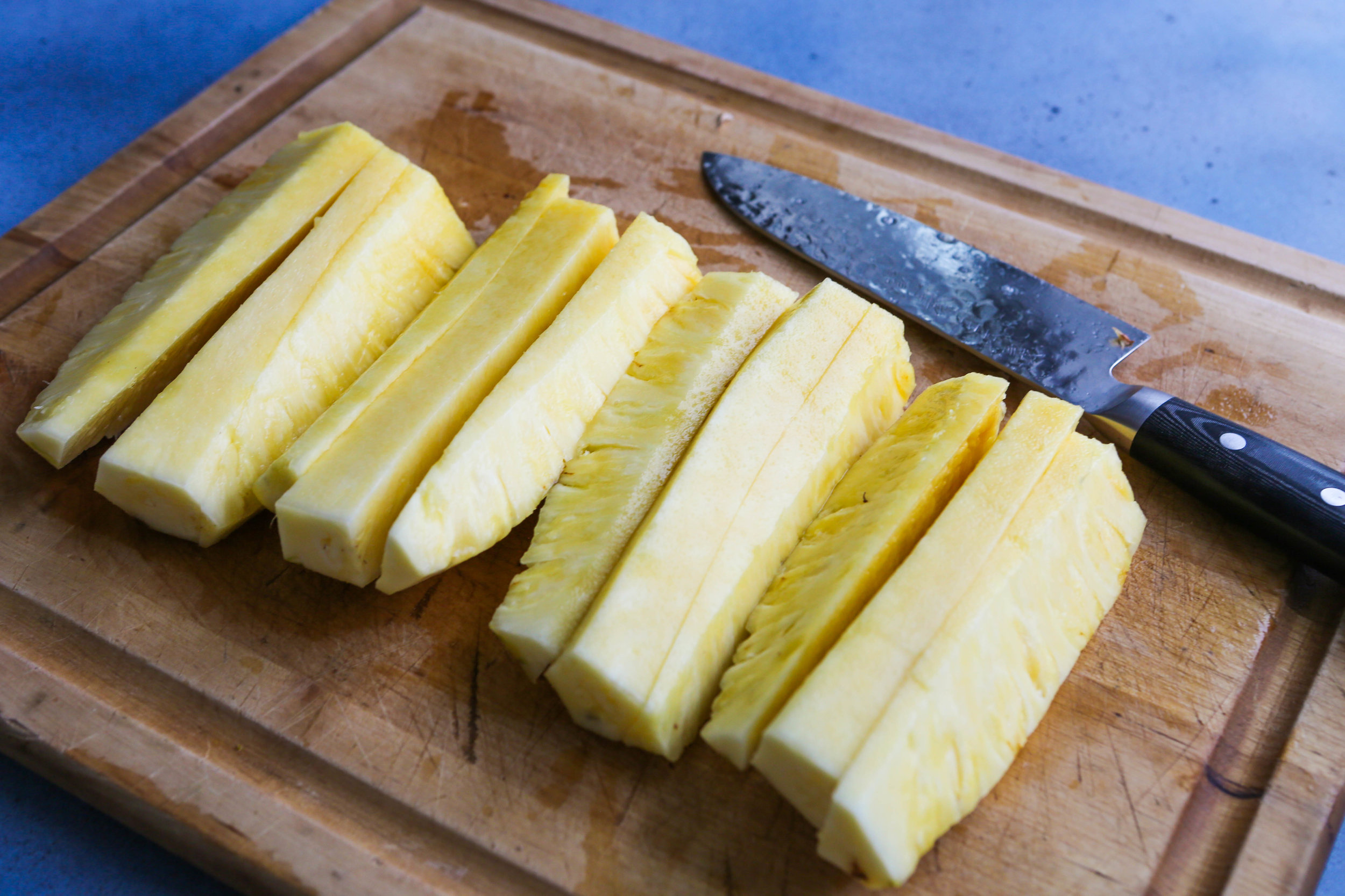 strips of fruit on cutting board