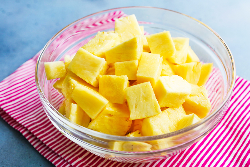 how to cut a pineapple: chunks sitting in serving bowl