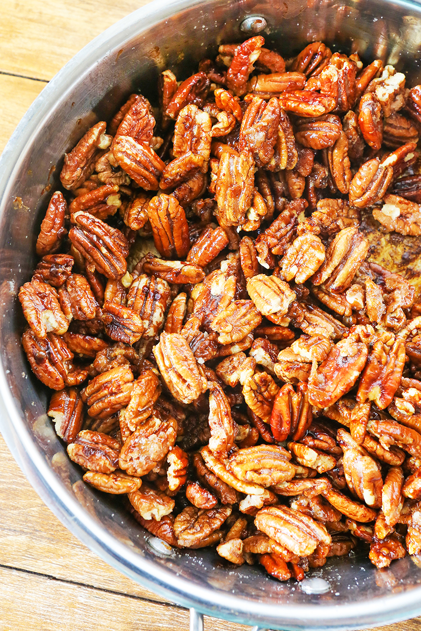 close up of large bowl of candied pecans