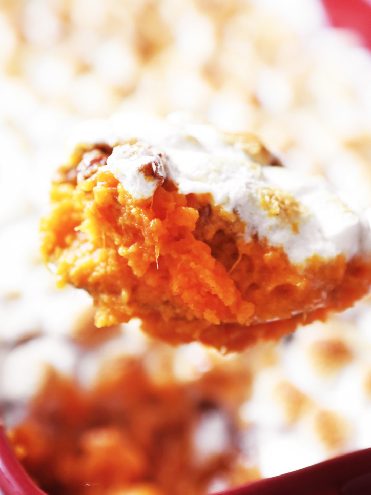 Spoonful of sweet potato casserole over pan