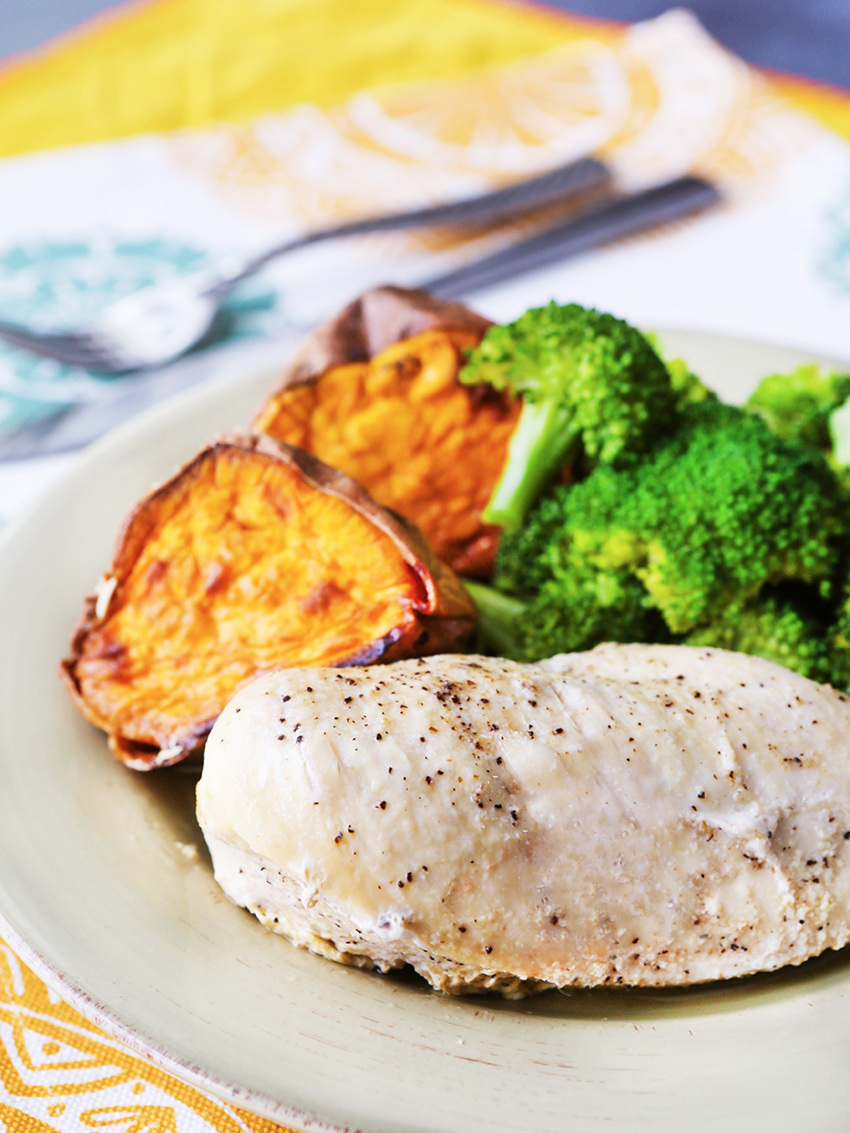 Dinner plate of seasoned chicken breast and side dishes