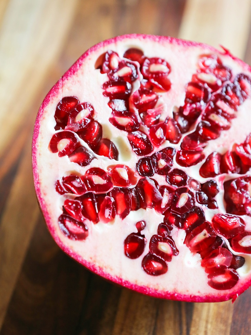 Half of a pomegranate with seeds