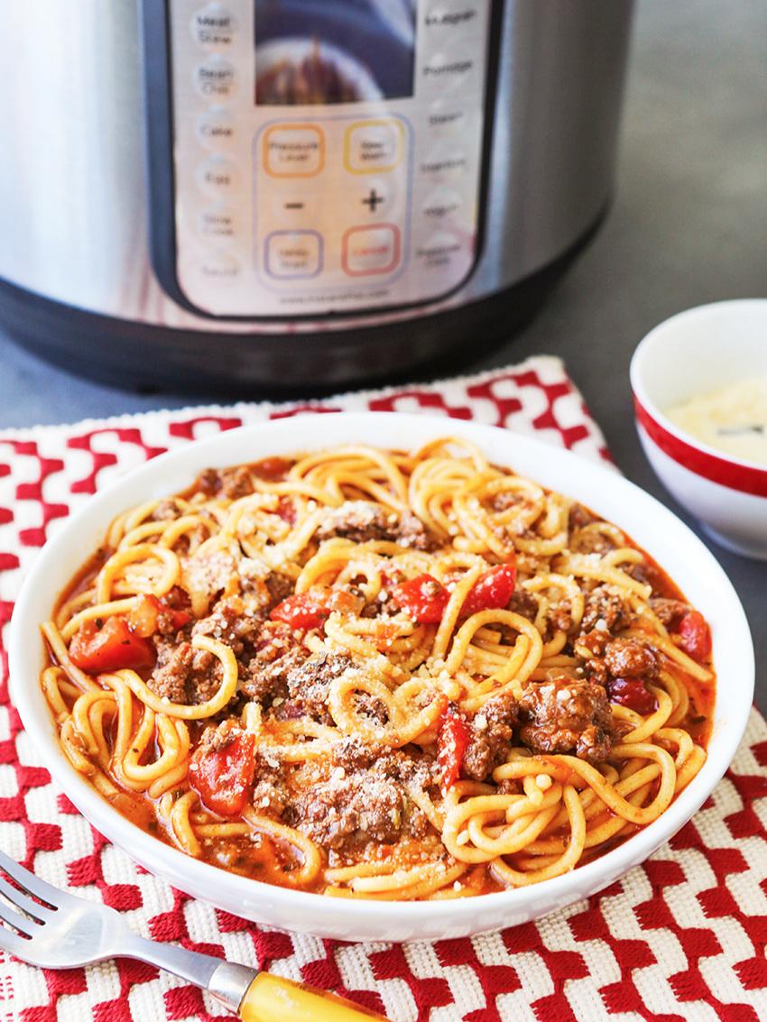 Bowl of spaghetti next to Instant Pot