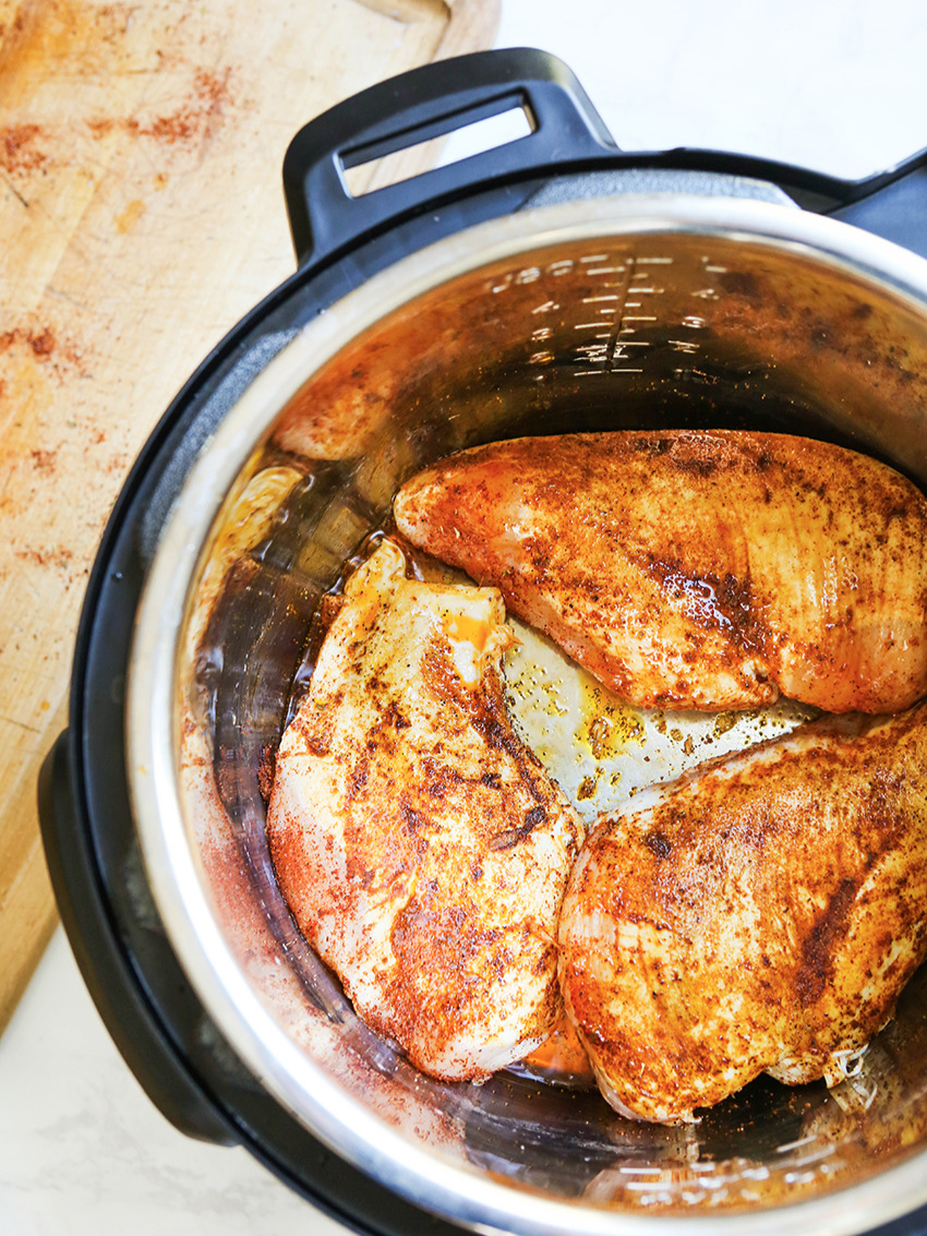Cooked seasoned chicken breasts inside the instant pot
