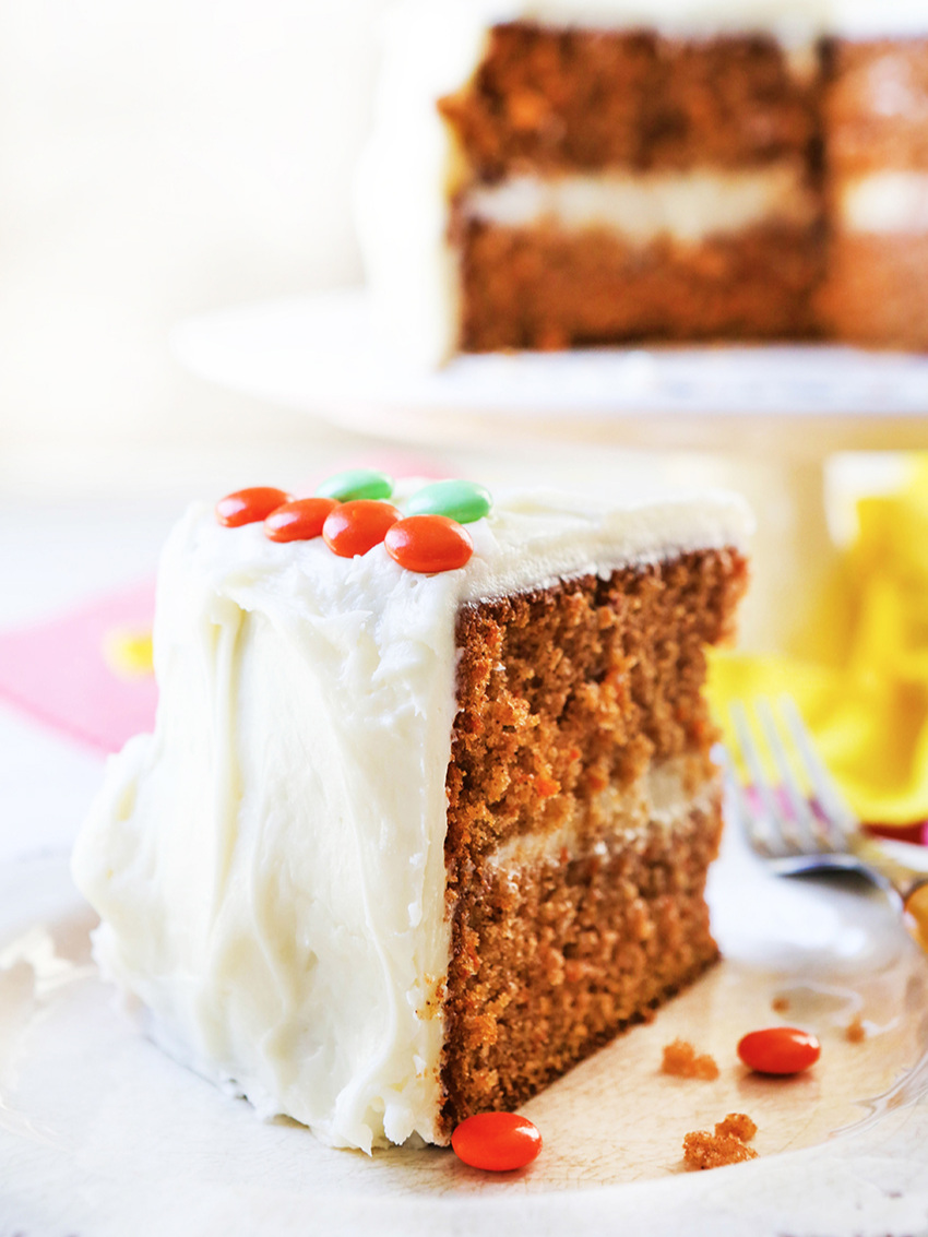 Slice of carrot cake with cream cheese frosting
